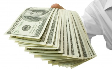 money in hands isolated on white (contains clipping path)
